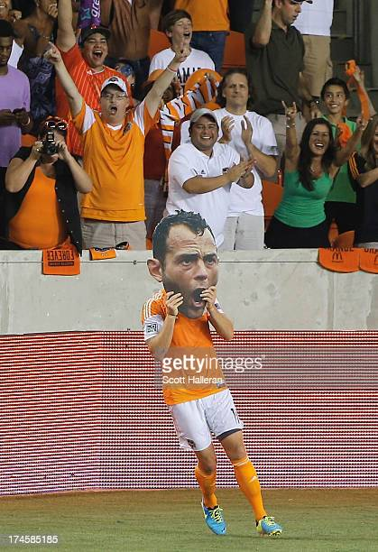 Brad Davis of the Houston Dynamo celebrates after assisting on a goal by teammate Cam Weaver against the Chicago Fire at BBVA Compass Stadium on July...