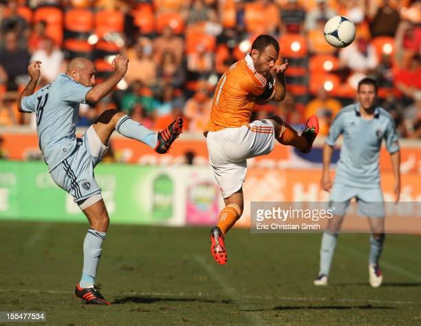 Brad Davis of the Houston Dynamo defends against Aurelien Collin of Sporting Kansas City during the first half of a MLS Eastern Conference Semifinal...