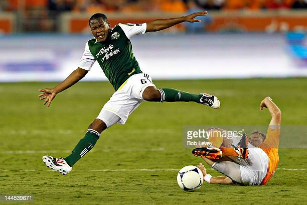 Brad Davis of the Houston Dynamo makes a sliding tackle on Darlington Nagbe of the Portland Timbers at BBVA Compass Stadium on May 15, 2012 in...