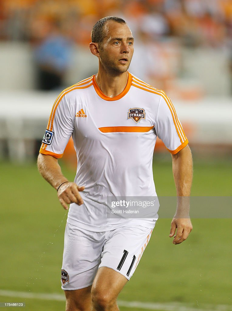 Brad Davis #11 of the Houston Dynamo works out on the field before the game against the Chicago Fire at BBVA Compass Stadium on July 27, 2013 in Houston, Texas.