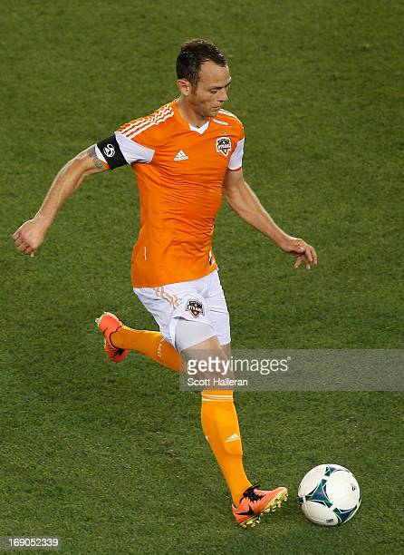 Brad Davis of the Houston Dynamo works the ball upfield against Sporting Kansas City in the second half at BBVA Compass Stadium on May 12 2013 in...