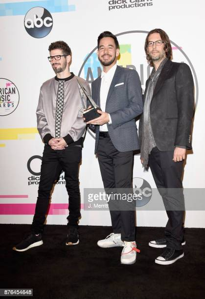 Brad Delson Mike Shinoda and Rob Bourdon of Linkin Park pose in the press room during 2017 American Music Awards at Microsoft Theater on November 19...