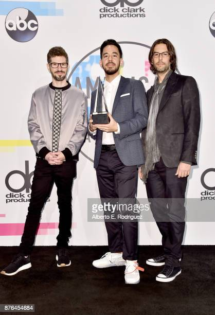 Brad Delson Mike Shinoda and Rob Bourdon of Linkin Park pose in the press room during the 2017 American Music Awards at Microsoft Theater on November...