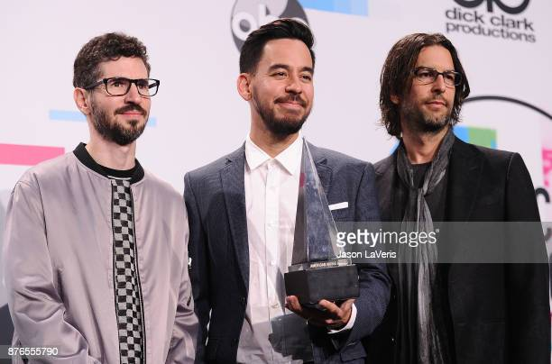 Brad Delson Mike Shinoda and Rob Bourdon of Linkin Park pose in the press room at the 2017 American Music Awards at Microsoft Theater on November 19...