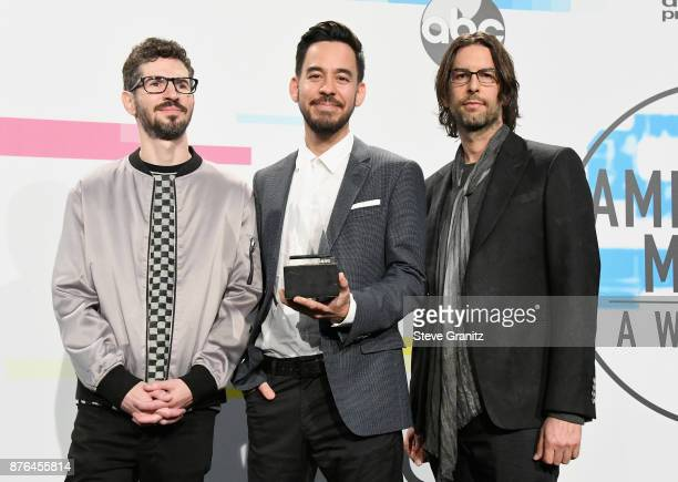 Brad Delson Mike Shinoda and Rob Bourdon of the band Linkin Park pose in the press room during the 2017 American Music Awards at Microsoft Theater on...