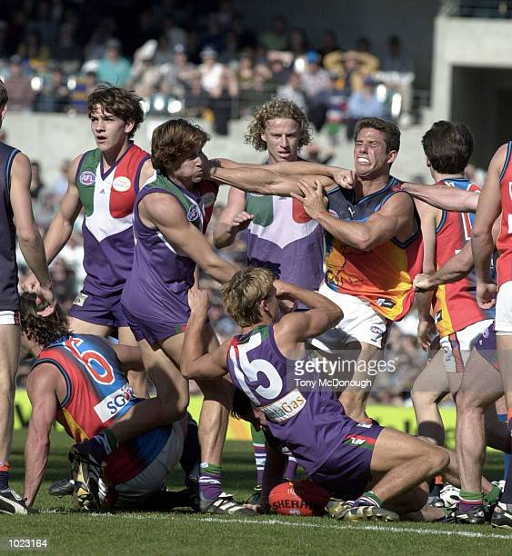 Brad Dodd for Fremantle gives Philip Read for West Coast a left hook during a brawl in the round 21 AFL match between Fremantle Dockers v West Coast...