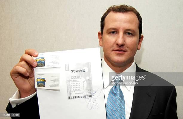 Brad Duke Powerball Winner with a Copy of the Winning Powerball Ticket