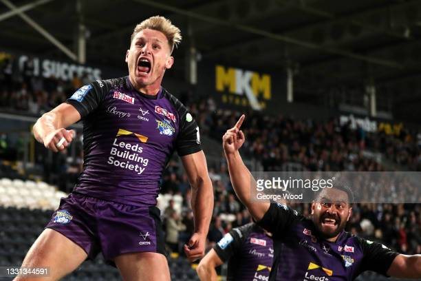 Brad Dwyer of Leeds Rhinos celebrates after scoring their side's first try during the Betfred Super League match between Hull FC and Leeds Rhinos at...