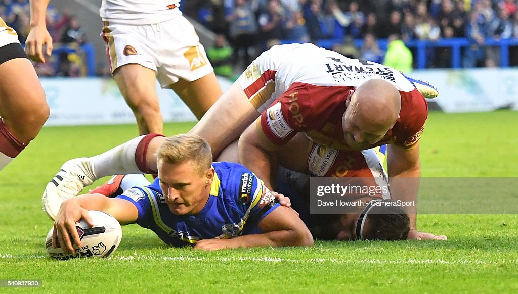 Brad Dwyer of Warrington Wolves scores his sides 3rd try during the First Utility Super League Round 19 match between Warrington Wolves and Catalans Dragons at the Halliwell Jones Stadium on June 17, 2016 in Warrington, United Kingdom.