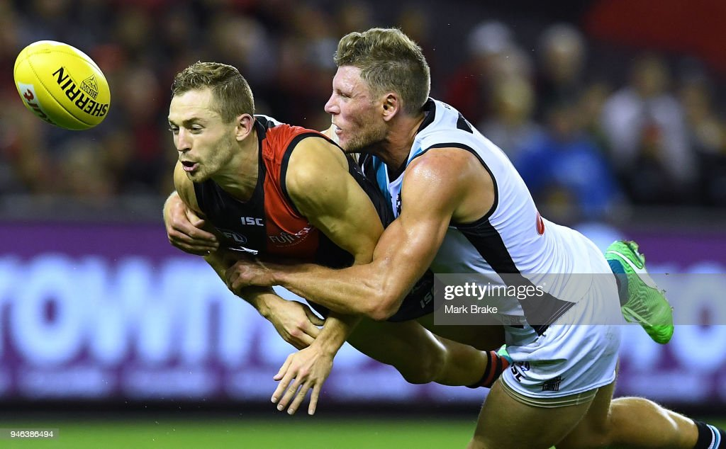 Brad Ebert of Port Adelaide tackles Devon Smith of the Bombers during the round four AFL match between the Essendon Bombers and the Port Adelaide Power at Etihad Stadium on April 15, 2018 in Melbourne, Australia.