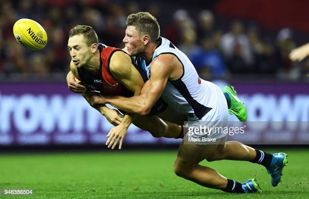 Brad Ebert of Port Adelaide tackles Devon Smith of the Bombers during the round four AFL match between the Essendon Bombers and the Port Adelaide...