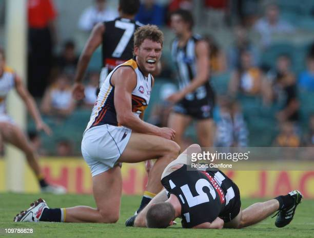 Brad Ebert of the Eagles looks at Nick Maxwell of the Magpies after a collision during the NAB Cup Semi Final match between the West Coast Eagles and...