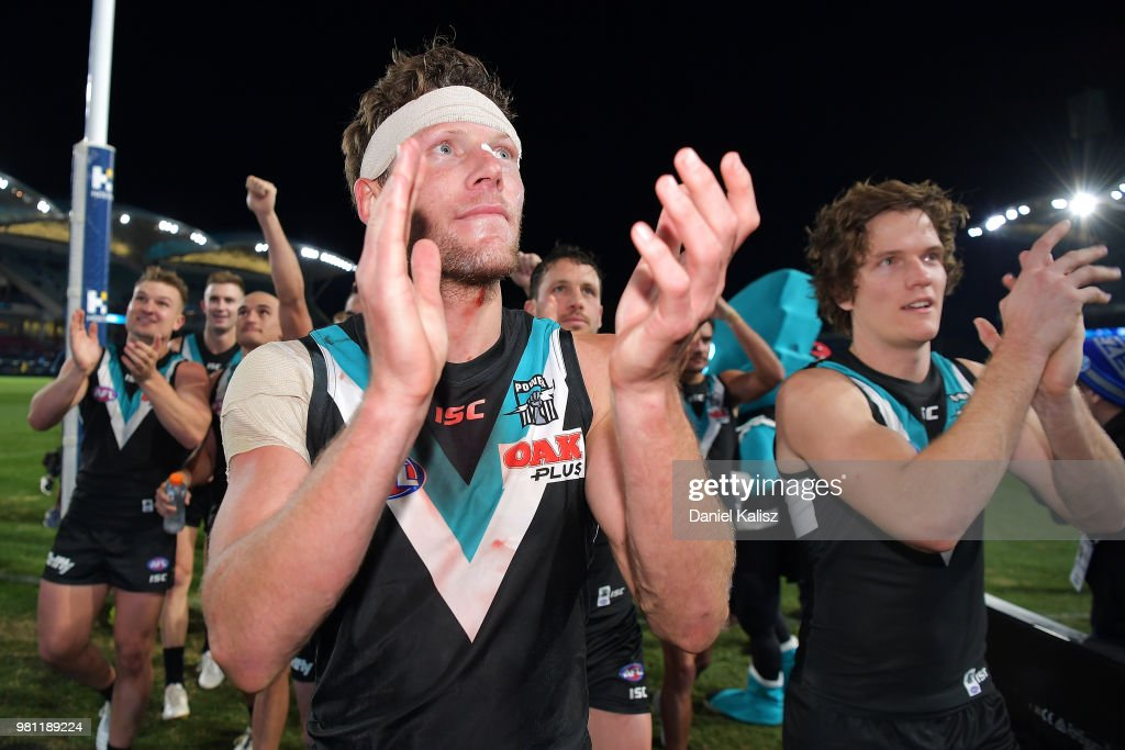 Brad Ebert of the Power reacts as he walks from the ground after the round 14 AFL match between the Port Adelaide Power and the Melbourne Demons at Adelaide Oval on June 22, 2018 in Adelaide, Australia.