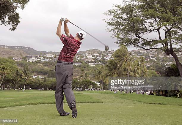 Brad Elder drives on the 12th tee during the first round of the PGA TOUR's Sony Open January 12 2006 at the Waialae Country Club in Honolulu Hawaii