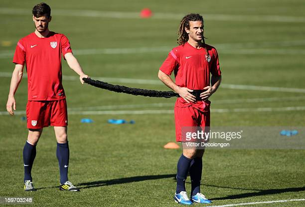 Brad Evans and Kyle Beckerman look on prior to doing a strength exercise during US Men's Soccer Team training session at the Home Depot Center on...