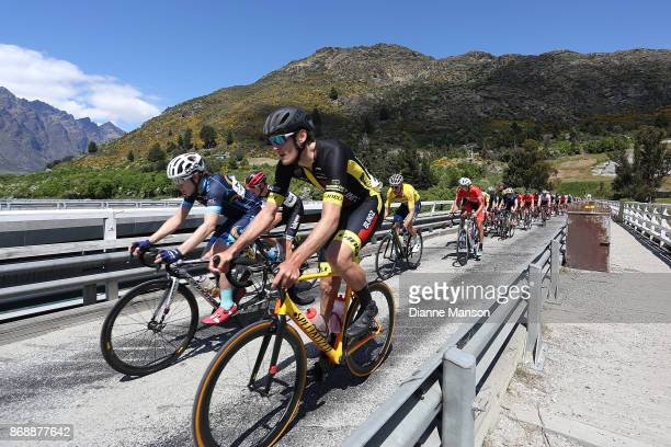 Brad Evans of Dunedin Powernet and Louis Crosby of Auckland Blindz Direct make their way over the bridge towards Frankton during stage 3 from...