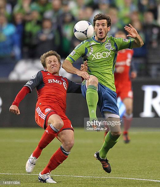 Brad Evans of the Seattle Sounders battles Terry Dunfield of Toronto FC at CenturyLink Field on March 17 2012 in Seattle Washington