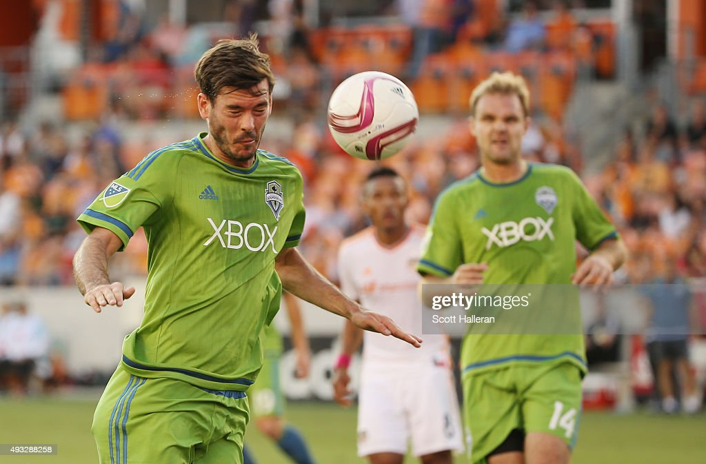 Brad Evans #3 of the Seattle Sounders FC heads the ball towards Obafemi Martins (not pictured) in the second half of their game at BBVA Compass Stadium on October 18, 2015 in Houston, Texas.