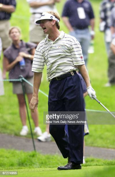 Brad Faxon follows his shot after teeing off on the eighth hole at the first round of the Buick Classic at the Westchester Country Club