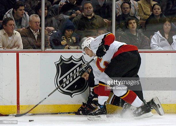 Brad Ference of the Calgary Flames and Shawn Thornton of the Anaheim Ducks go after the puck at Honda Center on December 18 2006 in Anaheim California