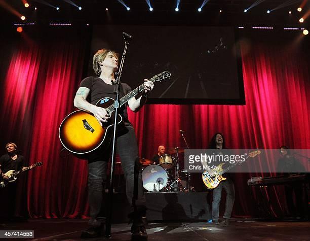 Brad Fernquist John Rzeznik Mike Malinin Robby Takac and Korel Tunador of Goo Goo Dolls perform during the 2013 Star 94 Jingle Jam at Arena at...