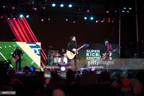 Brad Fernquist John Rzeznik Mike Malinin Robby Takac and Korel Tunador of Goo Goo Dolls perform at Liberty State Park on January 27 2014 in Jersey...
