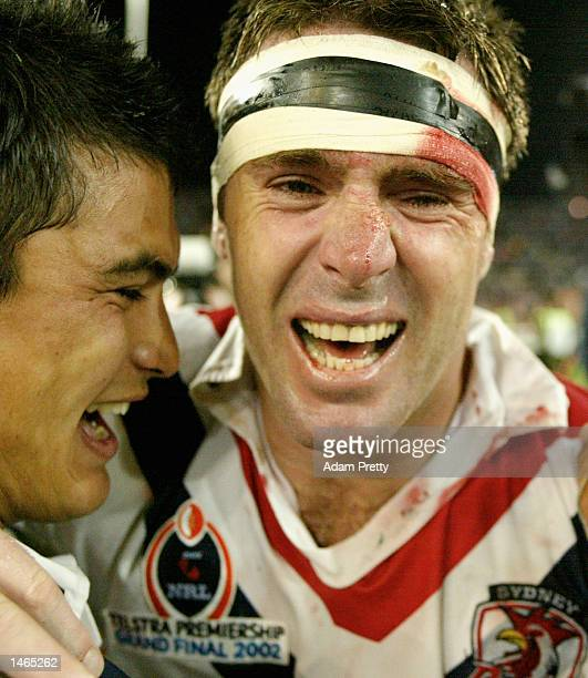 Brad Fittler and Craig Wing of the Roosters celebrate after winning the 2002 NRL Grand Final played between the Sydney Roosters and the New Zealand...