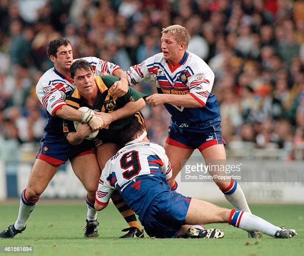 Brad Fittler of Australia is held by Lee Jackson and Denis Betts of Great Britain during the 1st Rugby League Test Match between Great Britain and...
