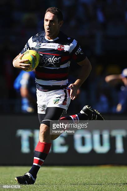 Brad Fittler of the Roosters makes a break to score a try during the match between Sydney Roosters and the Brisbane Broncos in the Auckland NRL Nines...