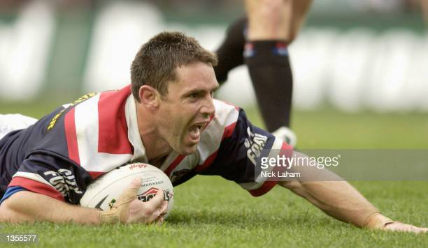 Brad Fittler of the Roosters scores a try during the round 24 NRL match between the Sydney Roosters and the New Zealand Warriors held at Aussie...