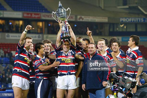Brad Fittler of the Sydney Roosters lifts the trophy after Sydney's victory in the World Club Challenge match between St Helens and Sydney Roosters...