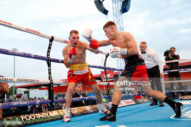 Brad Foster shorts punches Ashley Lane during the THE BRITISH AND COMMONWEALTH SUPERBANTAMWEIGHT CHAMPIONSHIP at The Lamex Stadium on May 18 2019 in...