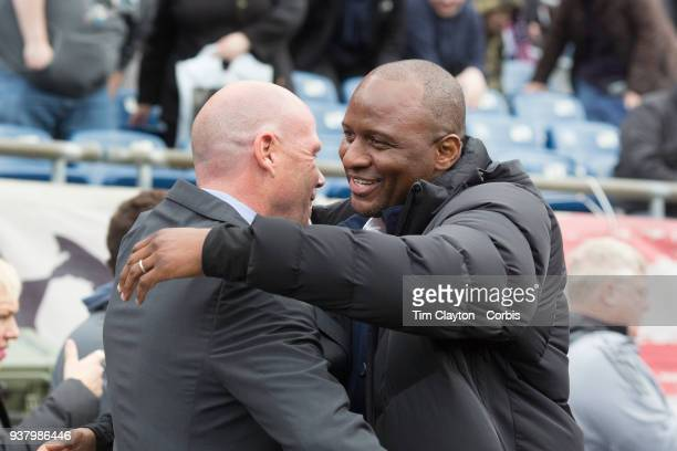 Brad Friedel head coach of New England Revolution and Patrick Vieira head coach of New York City FC embrace on the sideline before the New England...