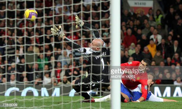 Brad Friedel of Blackburn Rovers blocks a goal attempt by Cristiano Ronaldo of Manchester United during their Premier league football match at Old...