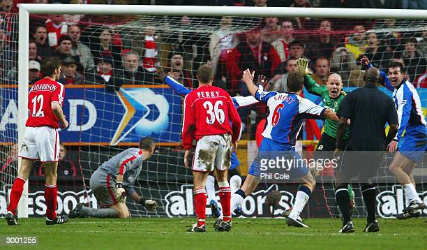 Brad Friedel of Blackburn Rovers is mobbed by his team mates after he scores their second goal during the FA Barclaycard Premiership match between...