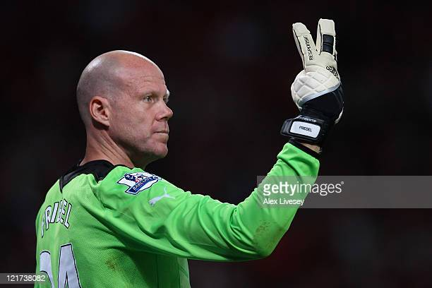 Brad Friedel of Tottenham Hotspur directs his defence during the Barclays Premier League match between Manchester United and Tottenham Hotspur at Old...