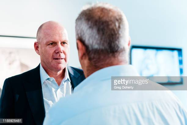 Brad Friedel talks with David Yarrow at the Maddox Gallery Los Angeles Presents The Disrupters by David Yarrow on June 13 2019 in West Hollywood...