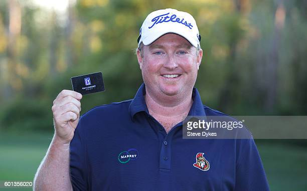 Brad Fritsch holds up his PGA tour card after the final round of the WinCo Foods Portland Open on August 28 2016 in North Plains Oregon