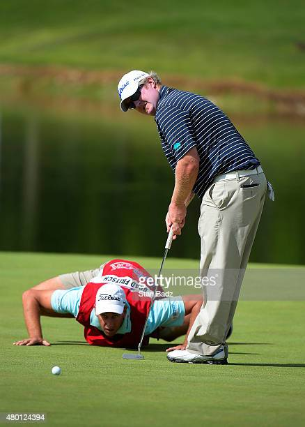 Brad Fritsch lines his putt with the help of his caddie on the fourth hole during the first round of the Webcom Tour Albertsons Boise Open presented...