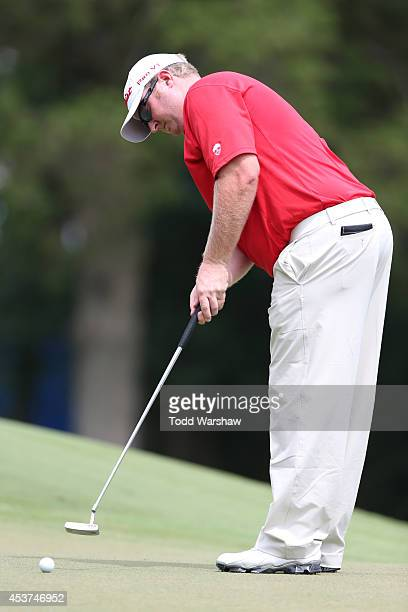 Brad Fritsch of Canada putts on the first hole during the final round of the Wyndham Championship at Sedgefield Country Club on August 17 2014 in...