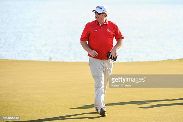 Brad Fritsch of Canada smiles after his sevenstroke victory on the 18th hole green of the Champion Course during the sixth and final round of the...