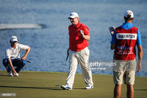 Brad Fritsch of Canada waves to fans after his sevenstroke victory on the 18th hole green of the Champion Course during the sixth and final round of...