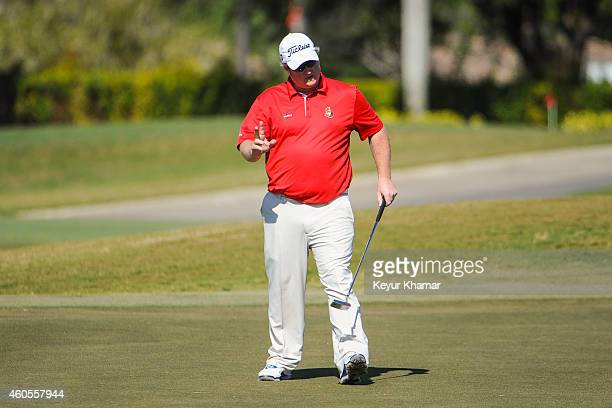 Brad Fritsch of Canada waves to the gallery after making a birdie putt on the ninth hole green on the Champion Course during the sixth and final...