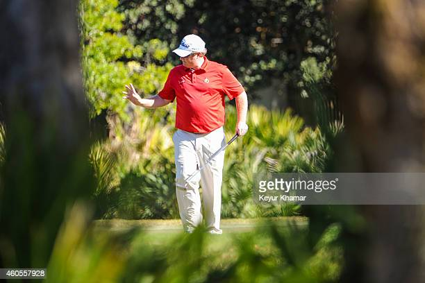 Brad Fritsch of Canada waves to the gallery after making a putt on the second hole green of the Champion Course during the sixth and final round of...