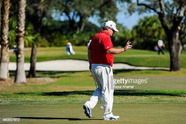 Brad Fritsch of Canada waves to the gallery after making an eagle putt on the third hole green on the Champion Course during the sixth and final...