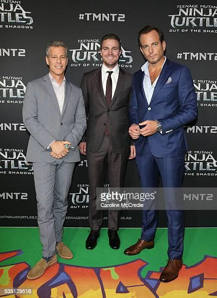Brad Fuller Stephen Amell and Will Arnett arrive ahead of the Australian premiere of Teenage Mutant Ninja Turtles 2 at Event Cinemas George Street on...