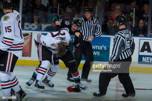 Brad Ginnell of the Portland Winterhawks drops the gloves with Erik Gardiner of the Kelowna Rockets during third period at Prospera Place on October...