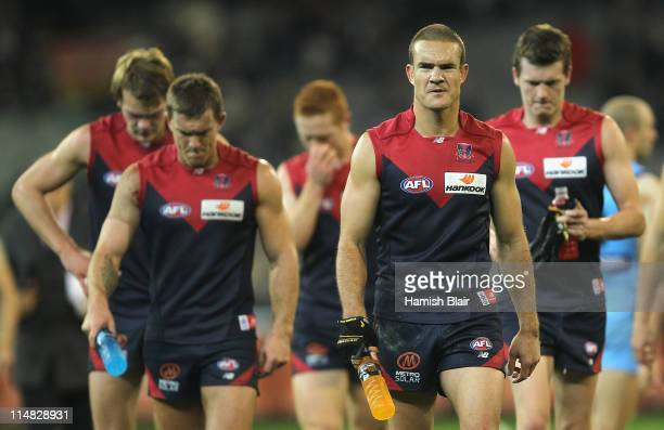 Brad Green of the Demons leads his team from the field after their loss after the round 10 AFL match between the Melbourne Demons and the Carlton...