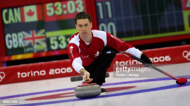 Brad Gushue of Canada competes in the preliminary round of the men's curling between Canada and Great Britain during Day 5 of the Turin 2006 Winter...