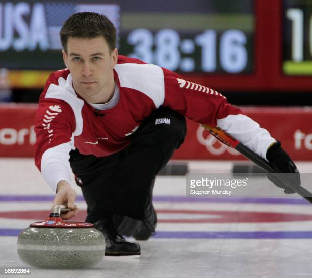 Brad Gushue of Canada eyes the stone during the preliminary round of the men's curling between Canada v USA during Day 10 of the Turin 2006 Winter...
